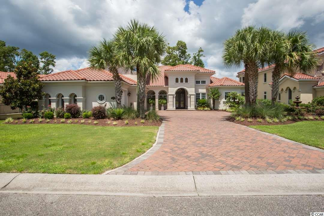 SIGNIFICANT PRICE IMPROVEMENT -PASS THROUGH THE MANNED GUARD HOUSE AND OVER THE WATERWAY TO VIEW THIS ELEGANT STEEL FRAMED 4BR/4 BA LAKE FRONT HOME WITH MANY EXTRAS INCLUDING A WHOLE HOUSE GENERATOR LOCATED IN THE GRANDE DUNES -  MYRTLE BEACHES MOST PRESTIGIOUS GATED COMMUNITY WHICH FEATURES TWO GOLF COURSES ONE OF WHICH IS TRULY PRIVATE . RESIDENTS ENJOY MEMBERSHIP IN THE 25,000 SQUARE FOOT OCEAN CLUB WITH ITS PRIVATE OCEAN FRONT POOLS, POOLSIDE AND FORMAL DINING ROOMS AND SECOND FLOOR MEETING ROOMS.  THIS ELEGANT 4BR/4BA STEEL FRAMED HOME FEATURES 4100 SQ. FT OF LIVING AREA WITH OVER 5700 SQ. FT. UNDER ROOF WITH WHOLE HOUSE  AUTOMATIC GENERATOR.  FEATURES INCLUDE – FIRST FLOOR MASTER WING WITH HIS AND HERS WALK IN CLOSETS, WINE AND COFFEE BAR WITH WINE COOLER. THE ADJACENT MASTER BATH INCLUDES HIS AND HERS ITALIAN HAND CARVED VANITIES , JETTED WHIRLPOOL TUB AND UNIQUE WALK THROUGH SHOWER.  THE GOURMET KITCHEN FEATURES CUSTOM CABINETRY , HAND CRAFTED BACK SPLASH WITH GRANITE COUNTER TOPS AND A VENETIAN PLASTER CEILING. ALSO LOCATED ON THE FIRST FLOOR IS A GUEST SUITE WITH ENSUITE BATH, FORMAL LIVING AND DINING ROOM AND AN ADDITIONAL FULL BATH WITH OUTSIDE ACCESS. THE FAMILY ROOM IS AMAZING WITH ITS FIREPLACE AND BREATH TAKING 25FT. VAULTED CEILING .   THE ELEGANT STAIR CASE LEADS TO THE SECOND FLOOR WHICH INCLUDES TWO ADDITIONAL BEDROOMS WITH AMPLE CLOSETS AND A FULL BATH. ALSO LOCATED ON THE SECOND FLOOR IS A LARGE  HEATED AND COOLED STORAGE ROOM.    EVERY WHERE YOU LOOK YOU WILL SEE CUSTOM HAND CRAFTED DESIGNER TOUCHES WHICH MAKE THIS HOME A ONE OF A KIND SHOW PLACE.
