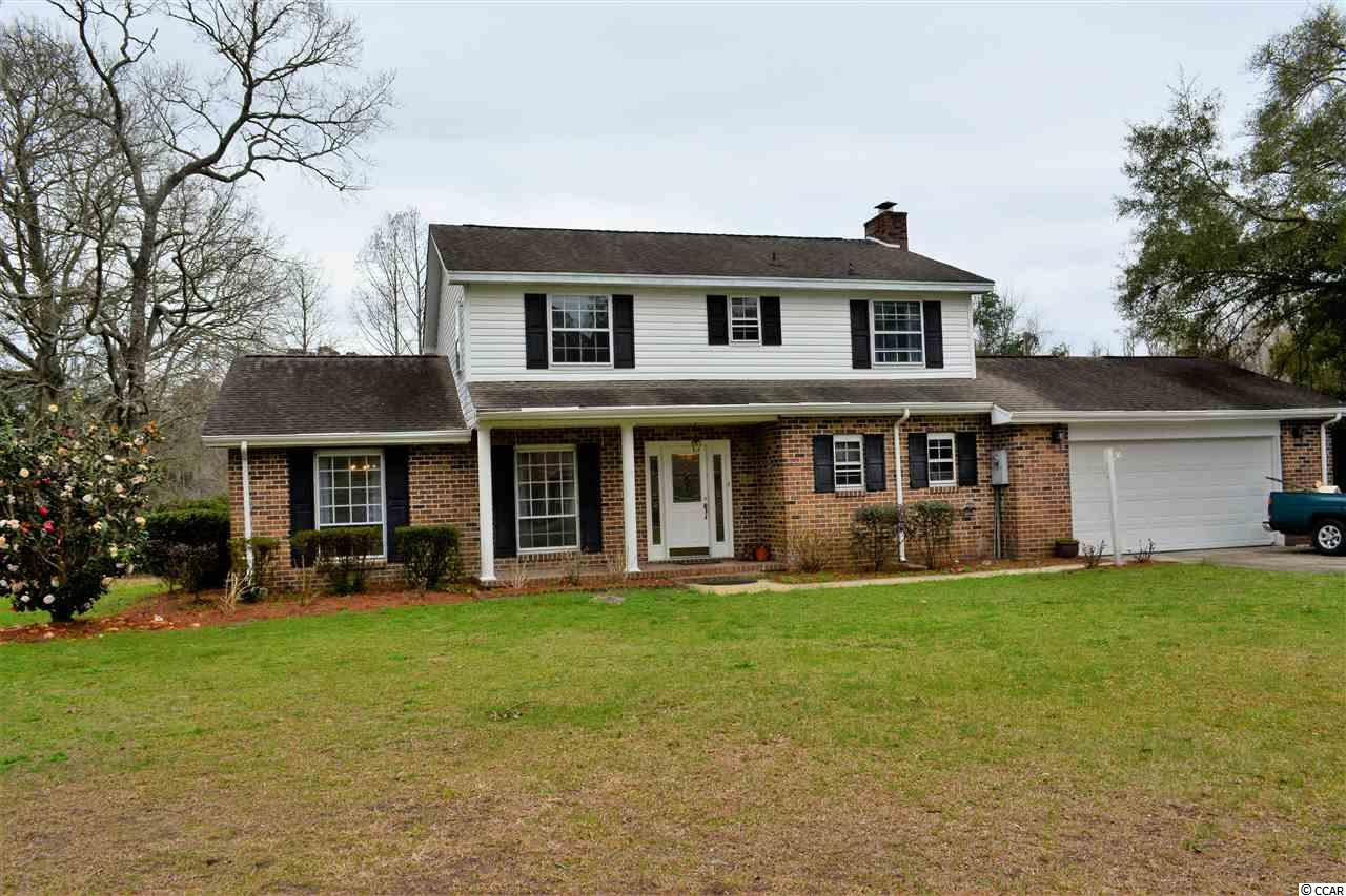 PRICE REDUCED !!! MOTIVATED SELLER. This is a lakefront home located in the well established Georgetown community of Belle Isle. There are 4 bedrooms and 2.5 baths, along with a shower that is located in the laundry room. This is very convenient if you have been working in the yard or the workshop.  There's a wood burning fire place located in the den. There is also a roof top deck located off of one of the upstairs bedrooms. Beautiful Camellias are located throughout the yard.  The front porch has room for rocking chairs.  The back patio offers room for grilling or outdoor relaxation and entertaining.  There is a formal dining room and living room.  The living room could also be used as an office or a media room.