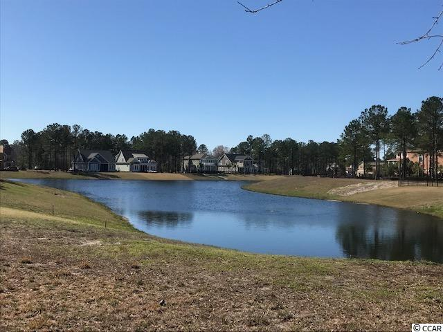 Beautiful lake front lot in the gated community of Waterbridge. This lot offers great water views and has a great building envelope. Community amenities include an amazing pool area, fitness center, walk down fire pit, swim up refreshment bar, tennis courts, volleyball and basketball courts,  boat ramp and pier. Located in the heart of Carolina Forest.