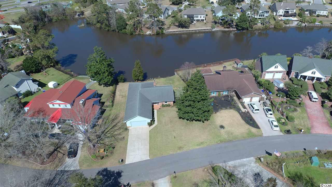 "This is a rare opportunity to have a lakefront home on Lake Dogwood in Surfside Beach ""The Family Beach"".  Just six blocks to the ocean, a short golf cart ride through a  quiet neighborhood. Lakefront houses rarely are offered for sale in this neighborhood.  One-level living."