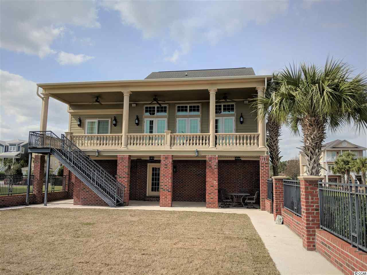 This immaculate Intracoastal Waterway home is a must see!  Located in the wonderful gated community of Paradise Island ! Luxurious living on an island located within 1.5 miles of Cherry Grove Beach and just south of the Swing Bridge!  Watch the yachts go by from your porch, and enjoy the beautiful Sunrises and Sunsets over the waterway.  Garage space under this home offers plenty of room for cars, golf cart, jet skis, workshop area, and storage.  Full bath and elevator in the garage. Living area offers spectacular architectural details with plenty of room for everyone!  8 ft high French Doors  provide amazing waterway views from inside as well as a huge porch across the rear of the home!  Chef's kitchen with Thermador gas range and griddle , double Thermador Ovens, and Sub Zero Refrigerator ! Hickory Cabinetry with granite countertops and a large island for entertaining guests in the kitchen as well.  Master bedroom on the main level offers waterway views with sliding doors to the rear porch... Master bath with custom tile jetted shower, and large whirlpool tub. Private water closet, Granite countertops, double vanity and huge walk in closet with custom cabinets.  Upstairs is just as amazing as the downstairs with 2 guest bedrooms, full bath, media or quiet reading loft.  TV and surround sound electronics convey with home. Washer/ Dryer also conveys.  Retirement Dream Home awaits you on Paradise Island!