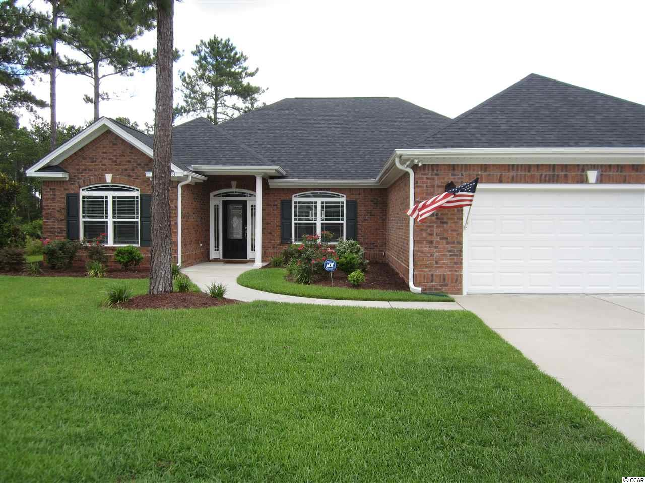 NEW YEAR  - NEW HOME!  REDUCED AND READY TO SELL! This is your chance to own an all brick, custom built home by Tom Wright on a premier lake lot in Covington Lake East.  The entire home was decorated by an interior designer and it shows like a model.  The extra details are apparent upon entering the home with the custom paint, wallpaper, crown molding, upgraded fixtures and plantation blinds.  Eat in Kitchen has custom maple cabinets, stainless steel appliances and granite countertops. Foyer, Dining Room and Living room have hardwood floors.  500 lb in ground propane tank for the fireplace and gas grill.  Enjoy outdoor living on the back 12 x 12 screen porch.  The bonus room behind the French doors can be used for a dining room but would make a fantastic office.  Laundry room leads to a 2 car garage with side access door.  Sprinkler system in the well maintained yard.  Covington Lake East is a gated community and has a community pool.  Measurements are approximate, Buyer to verify.