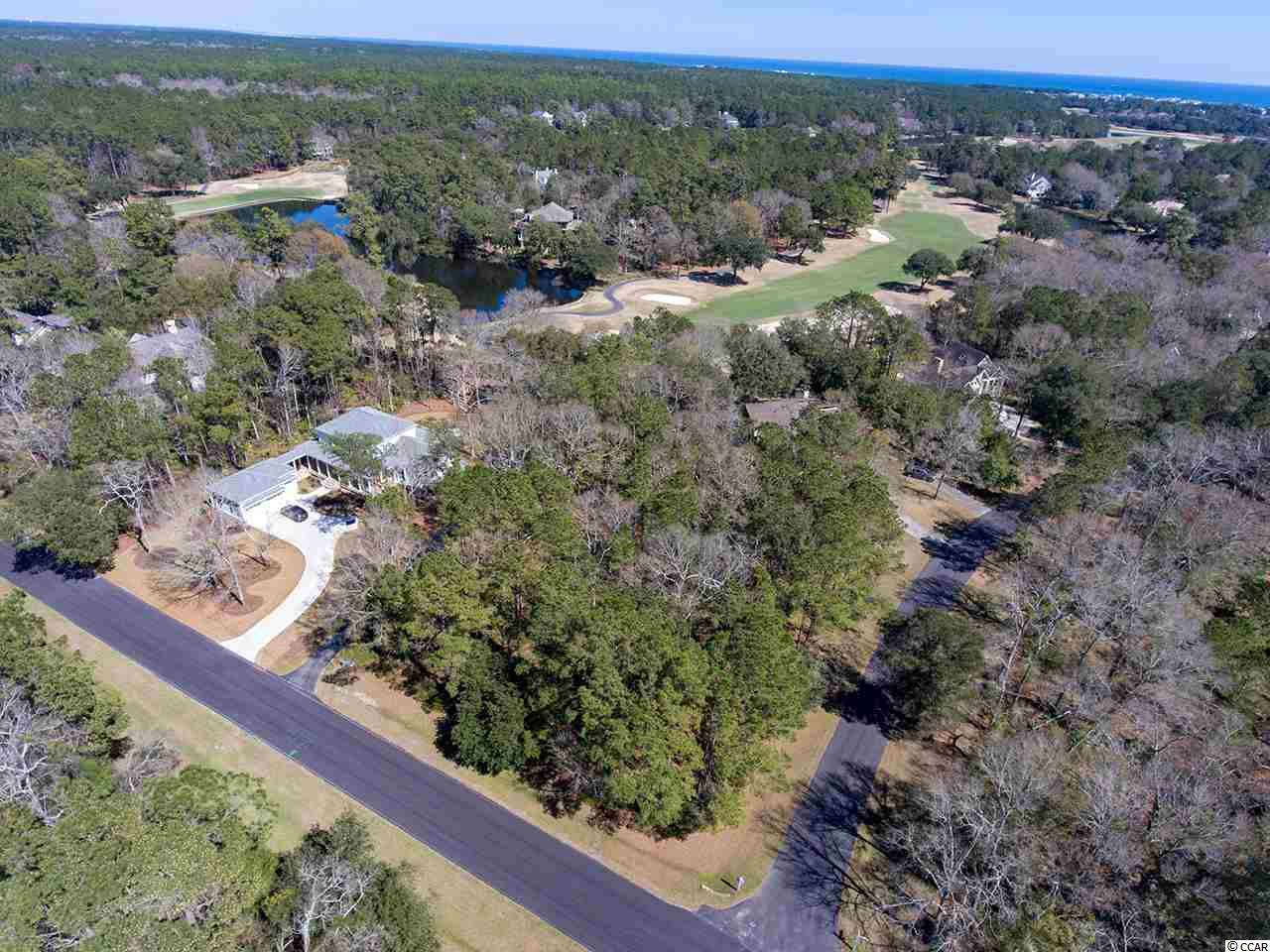 Golf Community - Large golf course home site just under (.98) one acre. It  rests on the corner of Wallace Pate and Jutland Lane  overlooking # 3 green with plenty of  beautiful trees.