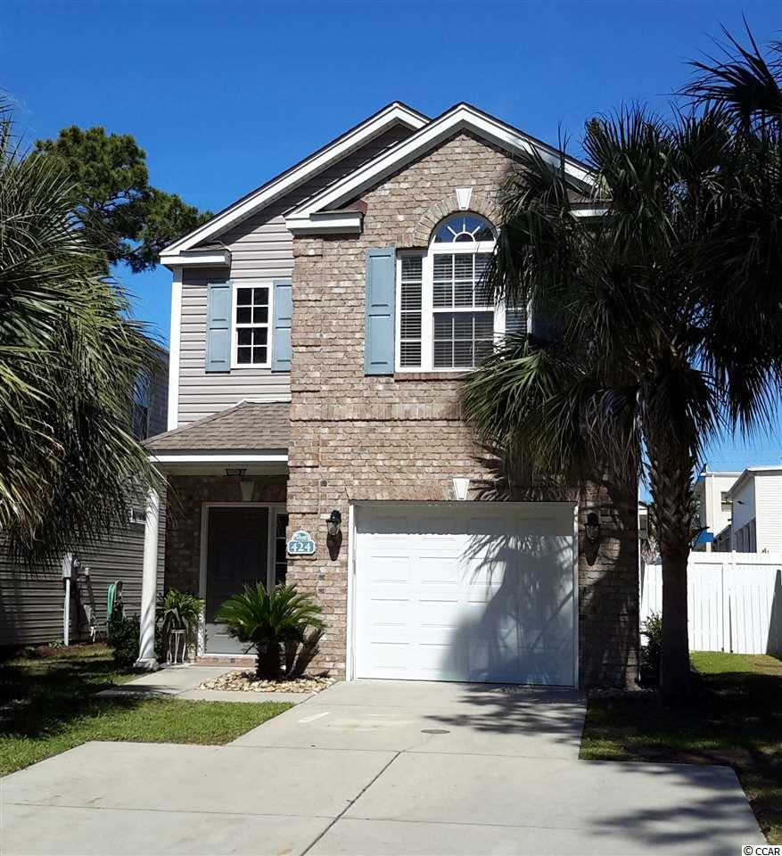 HUGE PRICE REDUCTION !!! Don't miss out on this rare find within walking distance of beautiful Surfside Beach and boasting it's own  private Pool!!!   You can hop in your golf cart and ride 5 blocks to the beach or cozy up with a good book next to your private inground pool! The pool was installed in the Spring of 2017 and has a heater/cooling unit to keep the water temperature exactly the way you like it so you can swim all year long!!. A bright and spacious living room boasts french doors that open to a concrete deck and private fenced back yard. The kitchen features granite counter tops and plenty of storage. There are tile floors throughout the first floor living area. The master suite is found on the first floor and three additional bedrooms upstairs each with their own private bathrooms.   This beautiful home is minutes from Surfside Beach Pier and close to shopping, restaurants and all the fun the Grand Strand has to offer!!  Stop dreaming about owning a beach home and make it a reality TODAY!!