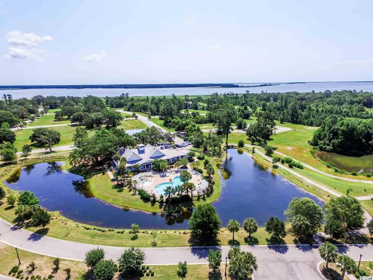 Build your dream home in this gated community located along Winyah Bay and the Intercoastal Waterway, near Historic Georgetown SC. The furnished club house includes a kitchen and bar along with a fully equipped fitness center.  Enjoy the pool, hot tub and kiddie pool.  RV and boat storage is available across from the community. All infrastructure is in place and waiting for you to build.