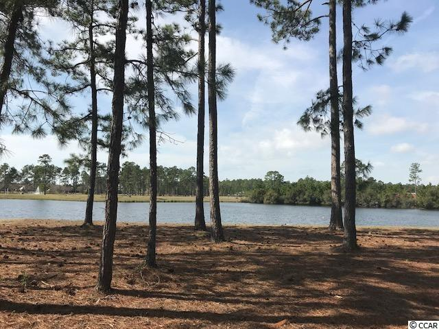 Beautiful lakefront lot in the gated community of Waterbridge.   Bring your own builder with no time frame to build!   Design the home of your dreams in paradise! Community amenities include an amazing pool area, fitness center, walk down fire pit, swim up refreshment bar, tennis courts, volleyball and basketball courts,  boat ramp and pier. Located in the heart of Carolina Forest.