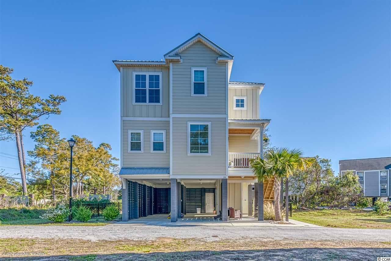 Experience the low country charm of this Litchfield creekside community. Marshland Park is east of 17 and only minutes to the beach, shopping, and dining. This beautiful 3 bedroom, 2.5 bathroom raised beach home is one of the largest floor plans in the community. With upgrades including wainscoting, custom cabinets, soft close doors, granite counter tops, stainless steel appliances, recessed lighting throughout, large walk-in pantry, tile backsplash, large walk-in closet in master with private deck, large laundry room, large workshop, under-house boat storage, sprinkler system, you will love this custom home! Enjoy HardiPlank siding, long-lasting metal roof, 2 outdoor living spaces, beautifully landscaped fenced in yard, luxury vinyl tile, tile in baths, Rinnai instant hot water system, custom solar shades on porches, elevator shaft already built in & more. Schedule your showing today!