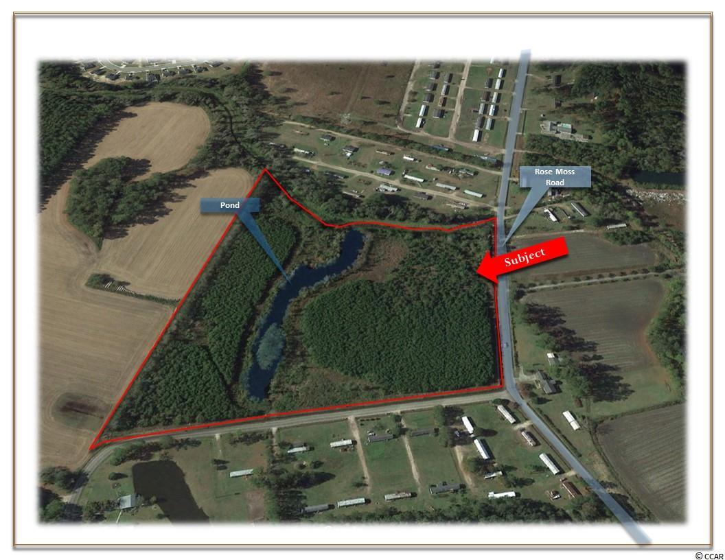 Property is Zoned Commercial and Residential OFFERED FOR SALE is this 20.50 +/- Acre Tract  located at the corner of Rose Moss Road and  D Street with a half acre +/- pond that extends to both sides of property. Zoned FA suitable for large estate, single family dwellings or manufactured/mobile homes.   GENERAL SITE INFORMATION: Approximately 20.50 /- Acres Approximately 790 Feet of Frontage on Ross Moss Drive   NEIGHBORHOOD: Conway is family-oriented small town with a nice historic district. In close proximity to Conway Medical Hospital, Coastal Carolina University, Webster University, Entertainment, Restaurants, Retail Shops, and a variety of local events. Approximately 1 Mile to Highway 501 From Rose Moss Road Approximately 5 Miles to Highway  22 Approximately 10 Miles to Aynor, SC. Approximately 12 Miles to Conway Medical Center  ZONING:  Forest Agricultural District (FA), County of Horry, SC.