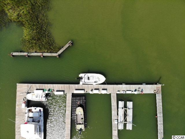 BOAT SLIP IN PROTECTED MARINA FOR UP TO 25 FOOT BOAT. GREAT ACCESS TO OCEAN BY MURRELLS INLET JETTIES.