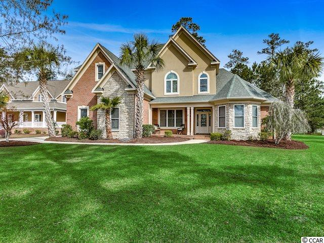 Splendid traditional grandeur in the Waccamaw River and Intracoastal community of Cypress River Plantation! Located in one of Myrtle Beach's most prestigious gated communities, this all-brick home on a half-acre showcases delightful and surprising features throughout including two expansive bonus rooms, a three-car garage, and a 13'x21' rear screened porch with multiple private access points leading out to the rear patio and backyard. As you approach the front door, you are sure to be enchanted by the quintessential feel of this home, with the dormers, multi-textural brick and stone, and established landscaping. Upon entering, you are introduced to to the open-concept common living areas and the abundance of natural light that brightens this home. The living area, formal dining, and kitchen welcome you home with hardwood and tiled flooring, high vaulted and tray ceilings. These areas are all interconnected, encouraging flow and freedom as well as an ease of gathering and entertaining. You'll be impressed with the large kitchen centrally located between both dining areas and overlooking the living area. The kitchen features granite countertops, a work island, a plethora of cabinetry and counterspace, breakfast bar, and walk-in pantry. The master bedroom is graced with a tray ceiling, sitting area, private access to the rear patio, screened porch, and backyard, and an ensuite bath with a walk-in closet, dual sink vanities, jetted garden tub, glass encased shower, and separate water closet. The other bedrooms are located on the second floor of the home. Two of the bedrooms share a full bathroom (Jack and Jill). The other bedroom upstairs has a private full bath. The second floor also includes two large multi-use bonus rooms. Cypress River Plantation residents enjoy a gated entrance with a guard, sidewalks and street lights throughout, owner's clubhouse, fitness center, basketball and tennis courts, large pool, boat & RV storage, day docks and a landing on the Intracoas