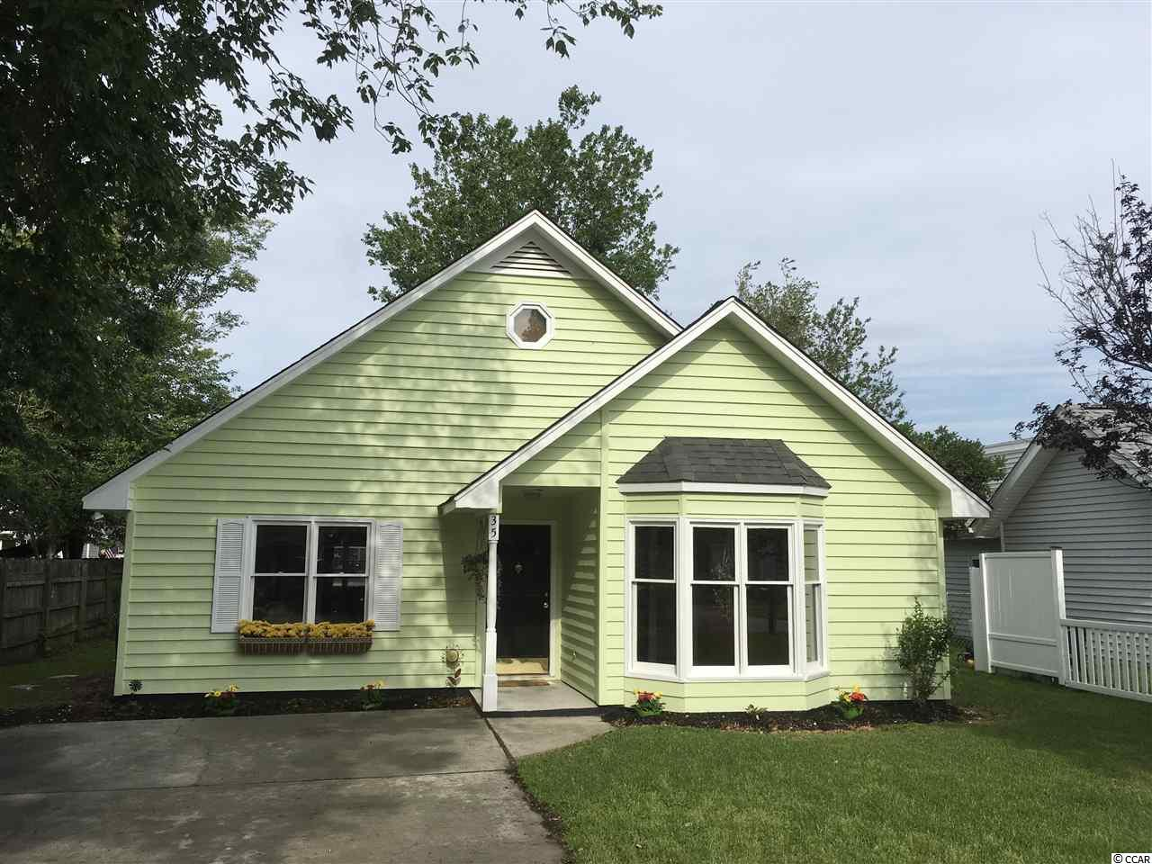 Great starter home, investment property or a 2nd home near the beach! Ready to move in to! Have you been hunting for a home with a fenced in yard, no HOAs, but also close enough to golf cart to the beach?  This spacious 3 bedroom/2 bath  has a brand new bay window(Pella) in the tiled kitchen, overlooking the front yard, and an enclosed Carolina Room that opens to a patio in the back.  Freshly painted on the exterior, new roof in 2018.  Fantastic location in family friendly Surfside Beach just west of business 17 off of Glenns Bay Rd.