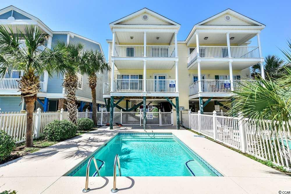 MUST SEE!! Beautiful 5 bedroom beach house just across the street from the ocean. Private pool, 2 exterior porches, and comes fully furnished. This home is perfect for an investment property, 2nd home, or primary residence.