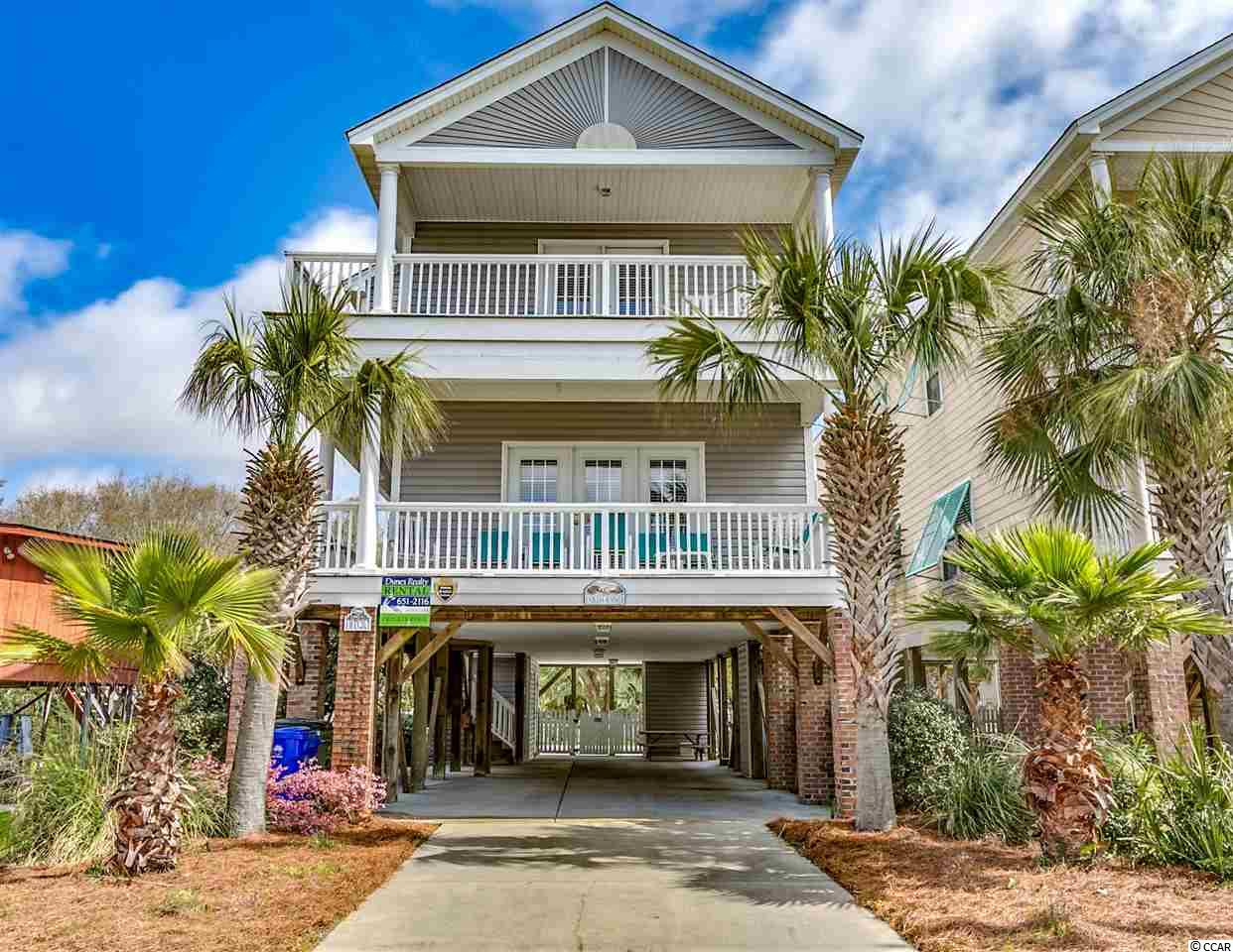 Closing scheduled for 9/16/2019. 110A 12th Avenue South known as Endless Summer is a fully furnished, five bedroom, five bathroom, 2612 heated square foot, single family raised beach house located 300 feet to the beach in the Town of Surfside Beach. Situated on an extra wide and deep R3 (zoned for vacation rentals) lot this two-story home has double front covered porches, ground level storage with room for a golf cart, parking for five cars, and low maintenance landscaping with an irrigation system. The fenced in backyard features a private walk-in pool, large patio, and plenty of flexible space to make this yard your oasis. The home, constructed in 2005, was built with an elevator shaft and pit (currently used as owner storage) ready for a residential elevator to be installed. The open living areas with tile and new LVT (Luxury Vinyl Tile) floors provide abundant space for large gatherings.  There are new granite kitchen countertops. The main level has direct access to the lower level covered porch off the living room, and there is a large bedroom and bathroom at the rear of the home. Upstairs there are four additional bedrooms, all with ensuite bathrooms, the laundry room and extra owner storage. The main master suite is located on the front of the home, has direct access to the second-floor covered porch, a bathroom with double sinks, and a garden tub/shower combination. The HVAC system has an existing warranty that expires in November 2022. The house has had over a decade of consistent strong rental history. The new homeowner will have the ability to offset their carrying costs utilizing the current homeowner's book of business managed by a local vacation rental management company. Why continue to rent when you can own a piece of one of the most beautiful stretches of the Grand​​‌​​​​‌​​‌‌​​​‌​​‌‌​​​‌​‌​​​‌‌​ Strand?