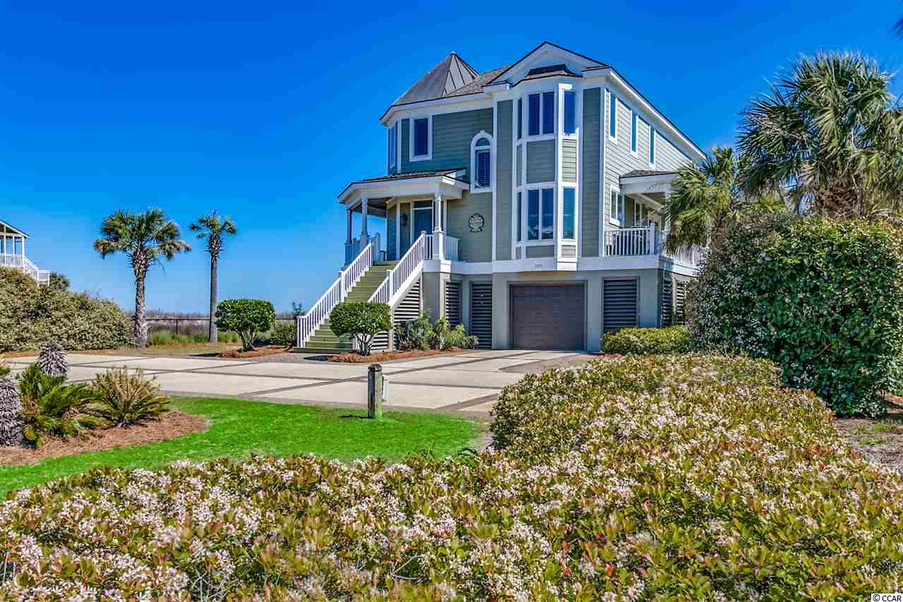 "IMAGINE A HOUSE UNITING everything you love about Coastal South Carolina in one unmatched location.  Meticulously constructed just 15 years ago inside the exclusive gated (with a 24-hour guard) community called Inlet Harbour, direct oceanfront AND private creekfront with boat access and a private dock.  This is one of only a handful such available oceanfront locations between Little River south to the Isle of Palms with private water boat access.  Within 15 minutes you can either be in the ocean heading toward the Gulf Stream or tying up to the Murrells Inlet Harbor Walk for cocktails and dinner.    In addition to the most ideal ""lay of the land...and the water"" and with underground utilities, this prestigious property boasts leaded glass over doors and transoms, tile flooring over the entire first living level, including foyer, family room, dining, kitchen, guest bedroom, full and half bath and office/study/or spare bedroom; and beaded-board ceilings in the family, dining and kitchen areas.  Rising off the first level family room beautiful flooring are Plantation Shutters all over, pine tongue and groove walls leading up to 10-foot ceilings of beaded board and crown molding.  Area rugs, recessed lighting and beautiful furnishings bring warmth to this first level.  Furnished?  Yes, fully.  A ground (enclosed garage with a new garage door, three showers and changing rooms) to top floor elevator (literally to the Master suite), will carry you to any level.  The kitchen, with Corian counter tops and a six-burner Thermador gas range, hand-painted tiles, walk-in pantry and eat-in counter is enlarged by opening Anderson sliding doors onto the spacious oceanside screened-in porch covered up in ceiling fans, dining table, comfy top-of-the-line Lloyd Flanders wicker and a ""Charleston"" Swing Bed, hand painted flooring and all leading to a boardwalk to the beach.  Head upstairs along a beautiful wooden staircase with oriental runner, brass brackets and exquisite chandelier overhead.  All hardwood flooring upstairs and tile in three full-baths.  The Master Bedroom has a vaulted bead-board ceiling, ceiling fan and recessed lighting, king size bed and direct oceanfront views through many windows.  You may never have to leave this bedroom to see the connection to gracious, salt-air outdoor living.  The Master Bath?  Pedestal tub/shower, two Kohler sinks and fixtures, Corian double vanity and again, oceanfront windows everywhere.  Walk-in closet with built-in drawers and a large upstairs laundry with tile flooring, sink and rack to hang your damp clothes to dry.   And so what else?  Locally famed home designer Fraser S. Wall. III and renowned builder, BEC Construction, Inc. have created a masterpiece to include a brick accented driveway, louvered garage and enormous storage areas with coded break-away walls, redwood railings and entrance-way to withstand the salty weather and all topped with an aluminum and architectural shingled roof.  What's not seen behind the walls?  Stainless steel nails used to prevent rust and 2 x 6's instead of customary 2 x 4 boards.  Dock usage with be on the northern side of the dock.  In Bar Harbor, Naples, Montank, Newport Beach or Southhampton, this oceanfront home, with its private deepwater mooring and access to the ocean by boat, would be worth millions more.   Now that you know a lot about this special kind of place, remember, the beach is all about the simple pleasures of life...the gathering of families, making memories or just doing nothing.  Nothing at all.  And the name of this property, appropriately called, ""The Laughing Place""."