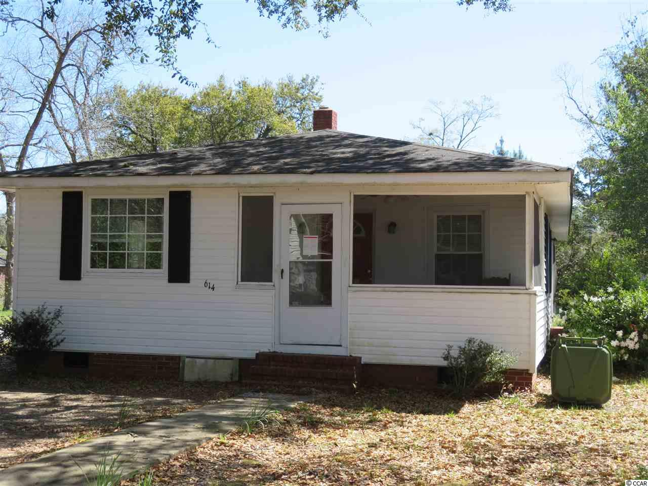 Here's your opportunity to own a home 1 mile away from historic Front street in Georgetown, SC. This 3 bedroom, 2 bathroom home is full of charm. Screened front porch and a detached 3 car garage adds so much character to this cozy property. Hardwood and laminate floors throughout. A little TLC will make this home the most comfortable home you could ever imagine. I forgot to mention, this property is on a 1 acre lot with no HOA and gorgeous live oak tees out front.! Schedule your showing today!