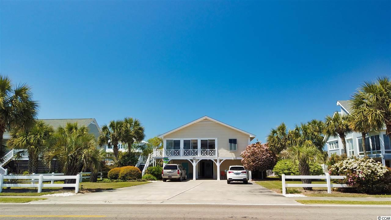 If you are in search of an inviting beach home, look no further. Whether you are strolling through the beautifully landscaped yard (in full bloom right now!) or  are relaxing inside, you will immediately feel comfort. On the top floor, you have views of the beach and the beautiful backyard complete with a pool. The front sunroom looks toward the ocean and offers a great spot for a bite to eat, a family game or simply a place to relax. As you step further into the home, you will find the family space, as well as the dining room and kitchen. Upstairs also includes two bedrooms and two bathrooms. Downstairs you will find three more bedrooms and two baths. This house has been lovingly maintained and it shows. You may see a video tour that takes you through the house by clicking on the virtual tour link. If you love what you see, schedule your private tour of this great home.