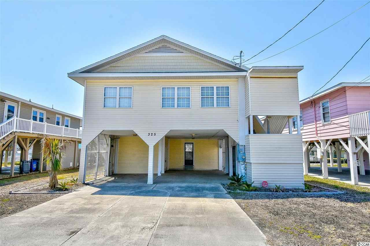 Located in Cherry Grove with beautiful channel views & only a couple blocks from the beach, this furnished home features a bright & open floor plan with lots of windows, a beautiful brick fireplace, and an amazing deck overlooking the channel.  The cozy kitchen offers ample cabinet & counter space for all of your cooking needs. each of the 3 upstairs bedrooms are generous in size and are beautifully decorated.  The additional bedroom and bath downstairs has also been remodeled.  Close to the Cherry Grove Fishing Pier, golf courses, Boulineau's, and great restaurants & entertainment, shopping and only a short car ride into Myrtle Beach and all that it has to offer.  This is your chance to own your very own Beach House - Schedule your showing today!