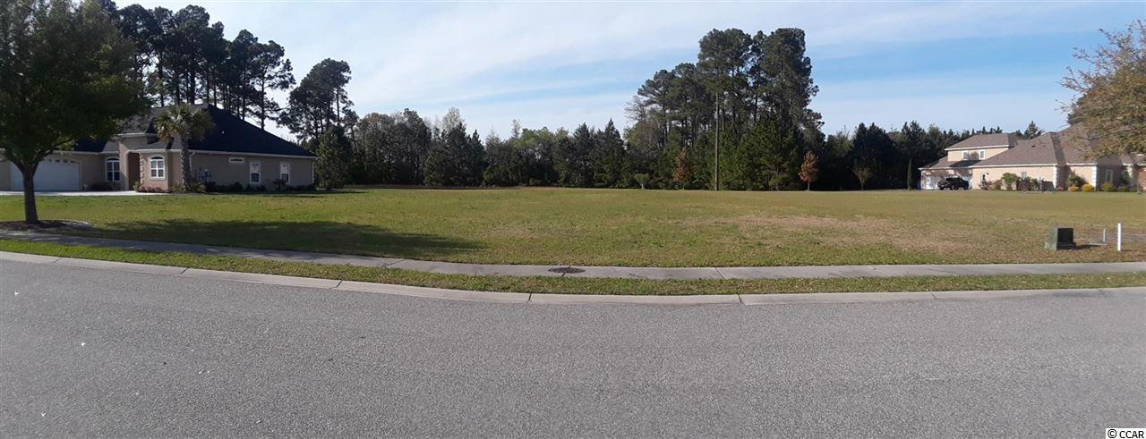 Build your dream home on this HUGE cleared home site. This is one of the largest lot(almost an acre) and it is wide. This lot is between 2 beautiful homes. There is no time limit to build! Ready to build and all the utilities there or buy now, build later! Shopping, dining, golf, hospitals, schools, including technical colleges and universities, are all just minutes away. You'll be only 10 minutes from the beach and Conway, SC! Check out the amenities available without leaving your neighborhood: Featuring a basketball court, lighted tennis courts, a private Owner's Club with a fitness center, 180 acres of freshwater lakes, creating almost 14 miles of lakeside shoreline, picnic and playground areas, onsite boat storage and even a private boat launch with ramp and day docks. The private pool complex has 3 pools, a water slide, and a splash zone! It's all here ~ all that's missing is you!  Come live the dream.