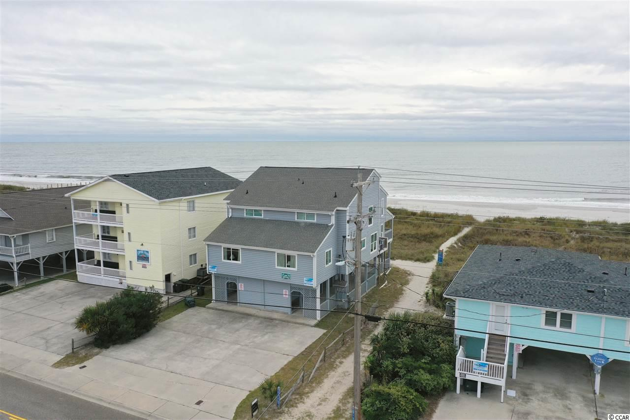 "OH WHAT A VIEW! 8 bedrooms & 8 baths  Fully Furnished OCEAN FRONT Duplex located in the Cherry Grove Section of North Myrtle Beach. 4 Bedrooms & 4 Baths on each side are ""mirrored images"" of each other. Renovations include New Flooring, all new windows & sliding doors, new A/C Units and new A/C Condensers, new siding, freshly painted exterior, new Hot Water Heaters and updates in the Bathrooms. Live on one side and rent the other side or enjoy a large home for Family or use as a Rental. HUGE ENTERTAINING SPACE under each side. With their own covered entrances. Spacious covered porches for each side and tons of dining options. Close to the Cherry Grove Fishing Pier & the Heritage Preserve Boat Launch & Pier. Buyer is responsible for all measurement verification's."