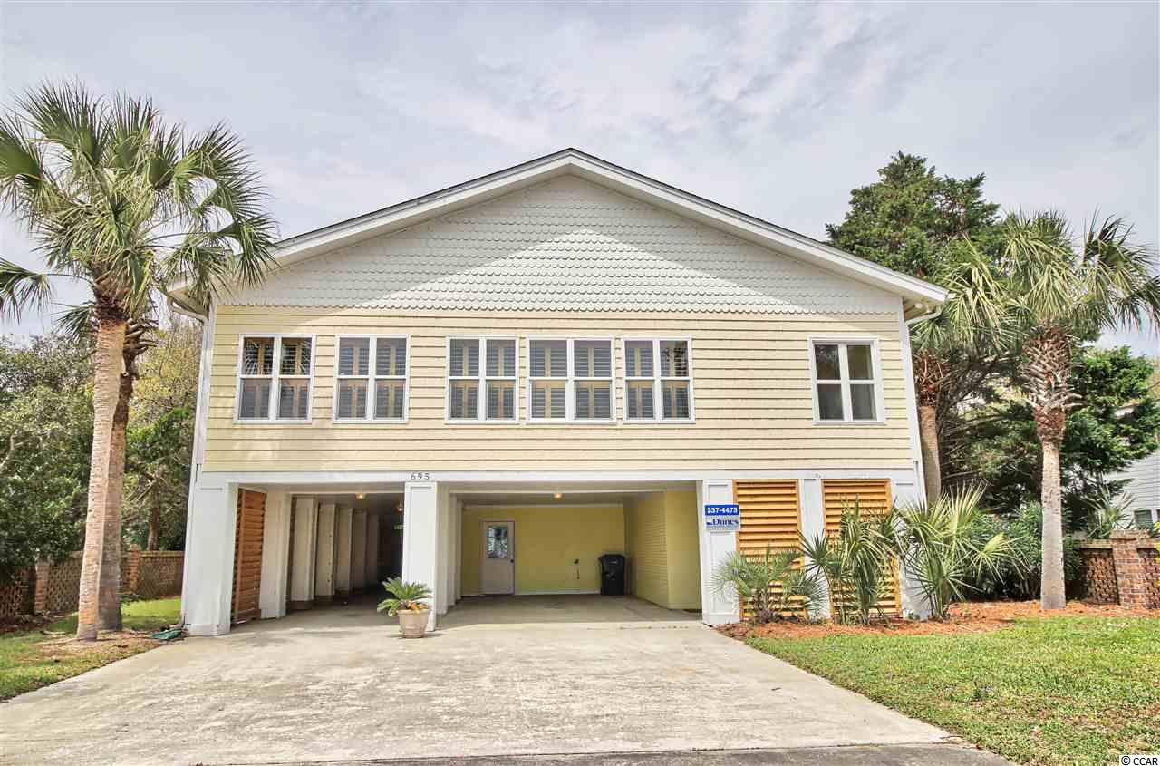 HUGE PRICE REDUCTION!! MOTIVATED SELLER of this gorgeous beach gem ~ Fully furnished, 2nd Row beach house in Pawleys Island. From the moment you enter this beautifully renovated smoke and pet free home you will feel the tranquility of beach living. Enjoy ocean views on every level and the peaceful sounds of ocean waves on this quiet street. Gorgeous refinished hardwood floors and cypress wood offer a warmth and homey feel in the living areas. Sit by the fireplace with a drink from the built-in bar or enjoy the sunroom with the endless screened windows and ocean views. Looking for a little privacy? Simply close the glass French doors in the sunroom and it's all yours. If you like to entertain, then you will love the large rooms and open concept this home offers. This spacious kitchen with tiled and hardwood floors and granite countertops not only offers endless storage and counter space but a large working island to entertain and remain engaged with your guests. Open the doors to enjoy the large deck for grilling or enjoy watching the birds from this meticulously landscaped private lot. There are two large bedrooms and two renovated bathrooms with tile flooring offering full bath/shower on main level. Upstairs you will find the sexy and very private master suite which spans the entire third floor. This true master suite oasis includes a sitting area with ocean views, fireplace, two huge walk-in closets and a master bath. This well thought out renovated bath has his and her sinks with vanities, separate tile shower, and jacuzzi tub surrounded by windows with ocean views. Add to the ambiance by opening the windows to take in the ocean breeze and romantic sounds of the waves crashing on the shore. The first floor has tile flooring, a storage room with a workbench, a large foyer perfect for bikes and beach gear, two large bedrooms and a renovated full bathroom. Enjoy the convenience of the outdoor sink and changing room/shower, outdoor storage room and patio area. The be