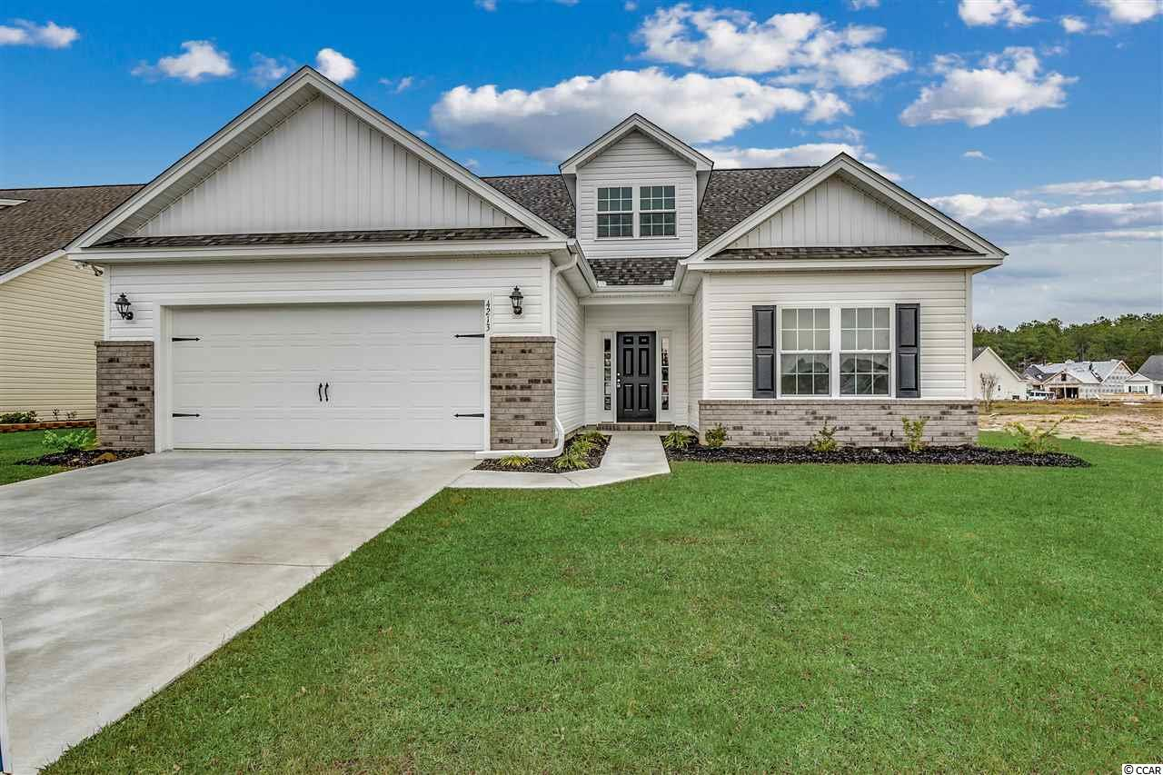 This is our Live Oak II model that has never been occupied and is copletely ready for occupancy.  It is located in beautiful Rivertown Row in the heart of Conway, SC.  It features 5 bedrooms and 3 full baths.  The Master Suite is on the main floor with two additional bedrooms.  The 4th and 5th bedrooms are upstairs.  There is a generous bonus area upstairs as well plus a full bath.  It has an open kitchen with a large dining area off of the kitchen.  The great room features beautiful vaulted ceilings and the Master Suite has a gorgeous tray ceiling!  It features upgraded waterproof laminate flooring in the main living area as well.  There is a covered porch in the back that overlooks a beautiful pond.