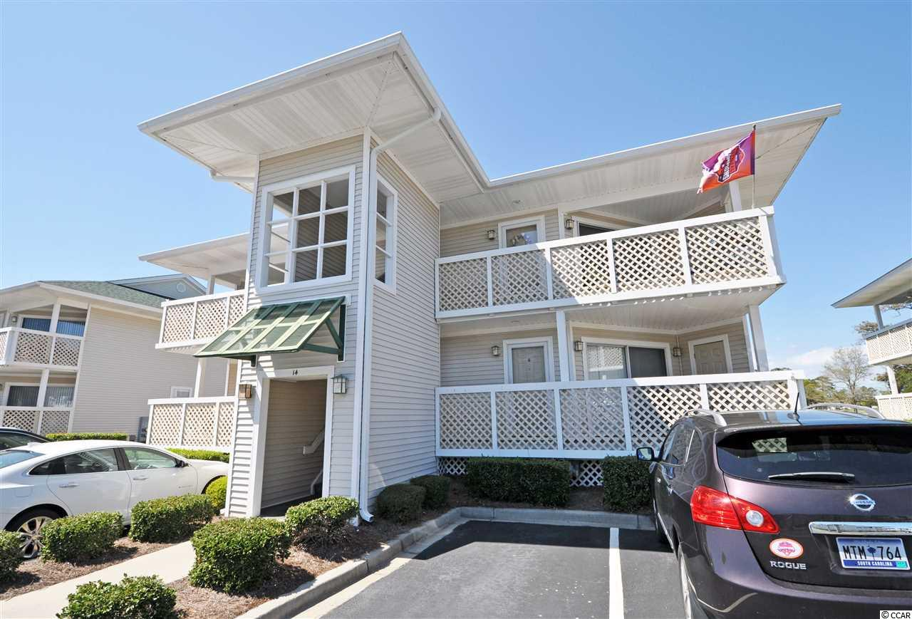 It is all about the Beach!  Nestled in a quiet lakefront, golf-course-view location in the Cherry Grove Beach section of popular North Myrtle Beach, Shorehaven 2 is a well-known, proven-value home, second home or investment community. It is across the street from the beach, just named one of the nation's best; and a safe designated walkway provides direct access -- important for families. The wide, white sand beach is truly just a few minutes stroll from this lovely, well maintained 2-bedroom/2-bath treasure.  Wonderful wrap-around balconies invite leisure time listening to the waves and watching the golfers, as the balconies also overlook the prestigious Surf Golf Club from the 10th hole as well as its tranquil meandering lakes. This small, private enclave of mid-rise thoughtfully designed condominiums has the Atlantic Ocean at its front entrance and the upscale amenities of a luxurious resort easily accessed within the complex -- a fabulous pool with hot tub & outdoor shower; grill; ample parking, only 4 units per quad; and a beautiful, peaceful environment. No motorcycles or trailers here. This spacious unit is perfect for a romantic getaway or a group, a family or a foursome. This particular building has no current rentals, and many residents are full-time. Its placement in the complex is preferred, too, for privacy and extraordinary views.  It is on the second floor so has a grand expanse of those Surf Club vistas. It is well and tastefully furnished throughout, even an electric fireplace in the living room...Enter into the great room and an upgraded open kitchen with granite counter tops, new dishwasher and pantry, and roomy breakfast bar with overhead recessed lighting. The dining room seats six; and the living area is large, cozy and lives comfortably. New Berber carpet adds to the well-planned decor, featuring a nautical/beach theme. The unit is being sold furnished. The big bedrooms are particularly wonderful! There are two fabulous masters with en suites,