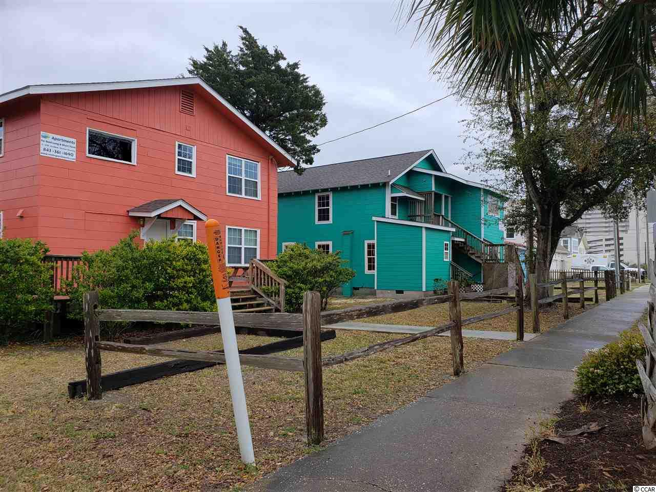 A four bedroom house built on a commercial corner lot east of 17 business a short walk to the beach, surrounded by beautiful properties, shopping and dining.  Located a short drive from Barefoot Landing.  ENTRY TO THE INTERIOR IS NOT AUTHORIZED!