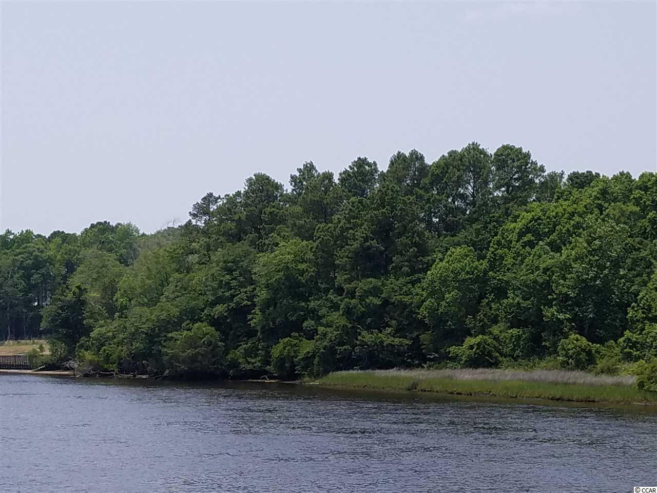 AMAZING OPPORTUNITY TO 140 FEET of DIRECT INTRACOASTAL WATERWAY FRONT! At just under 1 acre, this wide, highly desirable built site features: SECLUDED LOCATION, MATURE TREES, ABILITY TO BUILD A DOCK, NO HOA FEES AND NO TIMEFRAME TO BUILD! Perfect location in Little River, Near North Myrtle Beach Main Street, Little River Waterfront, golf, shopping, restaurants and THE BEACH! Claim your paradise today!