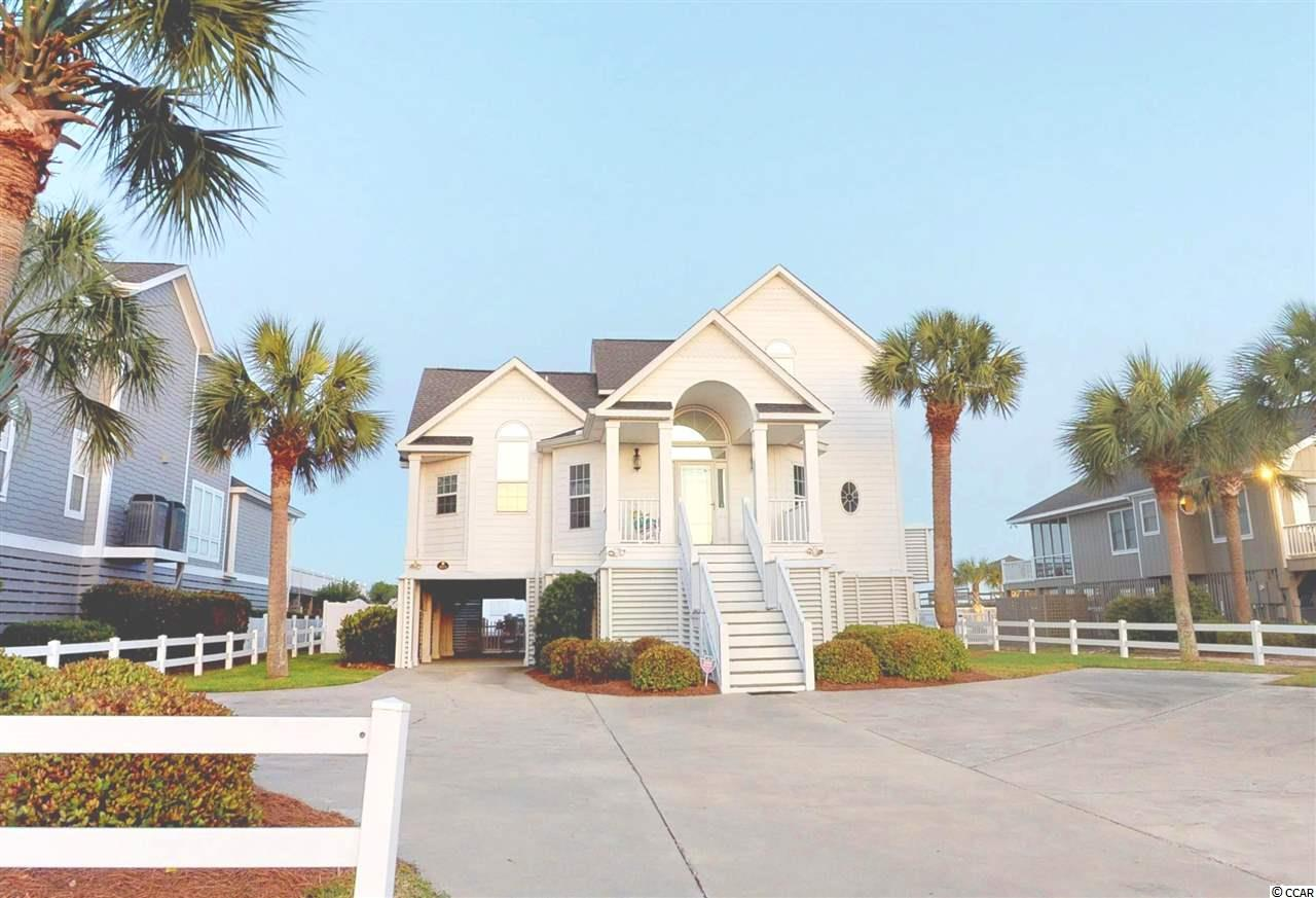 This is a rare find tucked away on the South End of Garden City Beach.  1433 S. Waccamaw Drive is a five bedroom beauty, a non-rental located on a 75 foot well protected dune line lot. With tons of parking, open floor plan, over-sized gunite (heated) pool, plus many more upgrades, make sure to put this oceanfront home on your list.  With gorgeous elevated views of the Atlantic Ocean, this property has an elevated walkway and views from almost anywhere in the house.  The open floor plan allows views through the living area and Carolina Room, and your first floor master bedroom is located on the back of the house, for great panoramic views out your window.  The elevator makes this home easily accessible to all, making this home the perfect beach property for you and your family.  Please contact the listing agent, or your Realtor, to schedule a showing!