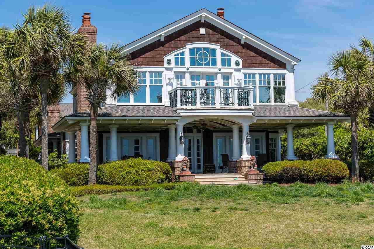 """Located on one of the largest oceanfront lots in the """"Golden Mile""""... this home is a """"must see"""" for the discerning tastes of those seeking the beach front lifestyle. Dating back to 1939 the home was completely renovated in 1998 and updated once again in 2015. The result is a breathtaking estate comprised of 2 living spaces independent of each other. Located just beyond the front gates is a spacious 2 bedroom, 2 bath Guest house perfect for hosting out-of-town visitors. Whether relaxing in the large family-room, sun bathing on the outdoor deck or swimming in the courtyard pool, there's truly something for every guest to enjoy. Throughout the 2-story, 3 bedroom, 3 1/2 bath main residence you'll find a masterpiece of exquisite Old World charm whose details and mil-work are truly one-of-a-kind! From coffered wood, detailed stenciling, medallions or cathedral...each ceiling is a work of art. This home has it all from the chef's kitchens outfitted with Sub-Zero  refrigerator, Thermador Professional double-oven and range, private beach front master suite with spa-like bath or multiple out-door living spaces...  this is one of the most incredible homes the Grand Strand has to offer!"""