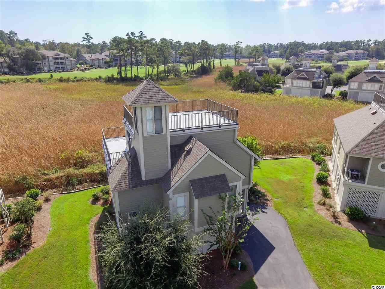 """You will think you arrived on HGTV  --- Affordable views beyond your expectation.  Oh, by the way, the views come with the home!  3 BR, 3 BA and 4 outdoor areas...3 decks and entire ground area beneath the house.  The screened porch allows you to scope serene marsh grasses with the 18th whole of Tidewater in that same view.  Climb the spiral stairs to experience a true """"roof top"""" event.  Enjoy waterway, marsh and golf course panoramic sights.  4 more perks include no landscape work, access to a waterway pier and a community dock for boating/fishing excursions AND no worry about exterior painting!  As this is in a rotation and is included in the monthly HOA fees.  OH, and did I mention all of the other perks of Tidewater such as pool, tennis courts, fitness center and beach cabana!?"""