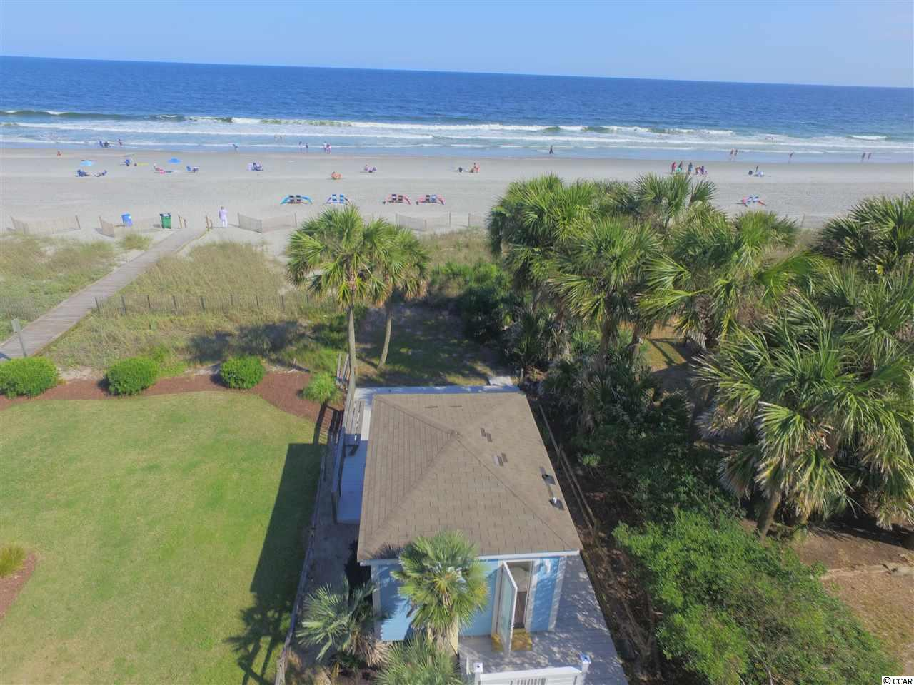 This remodeled day cabana is truly your piece of paradise located on the oceanfront.  What makes this so special is the prime location and the rarity of this highly sought after gem on the pristine white sands of  Myrtle Beach.  Your diamond on the beach has been renovated inside and out in a cool Coastal theme.  Enjoy the large deck, yard for sunning and games, convenience of a restroom, air conditioned, napping couch, dish sink or wet bar, full size refrigerator, beach accessory storage, outside shower and amazing views and sea breezes from this oceanfront property while you enjoy the beach.  Awesome location to have oceanfront cookouts with friends and family or just enjoy some well deserved solitude at the beach.   The exterior is durable concrete fiber cement siding.  The location is central to all the fun of the Grand Strand including shopping, dining, golf and attractions.  Don't miss out on this special opportunity.
