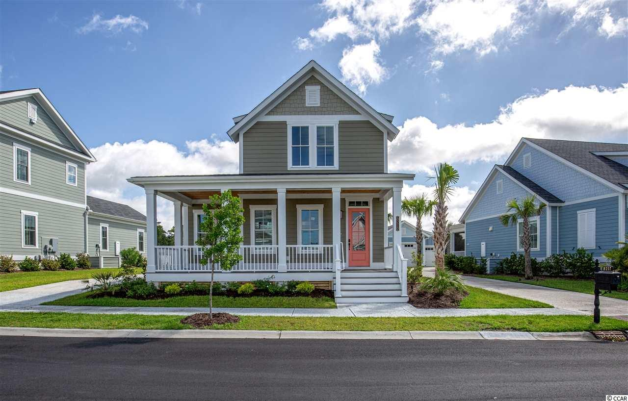 At 2,166 heated sqft, the two story Cooper home located on lot 8 offers 3 bedrooms with a first level master suite and 2.5 bathrooms.  This Cooper home features beautiful reclaimed wood flooring in all the common areas, upgraded kitchen cabinets, granite countertops, tiled kitchen backsplash, and Kitchen Aid stainless steel appliances with a natural gas stove. The master suite features a tray ceiling, walk in closet, and tiled shower.  The one car garage comes with a golf cart garage as well allowing you to take a golf cart ride to the ocean only 3 blocks away.   Quality construction is a priority at Living Dunes. All homes built with 2x6 exterior walls, spray foam insulation, tank-less water heater, high impact-resistant windows, designer series shingles, custom Elmwood cabinetry certified by Environmental Stewardship Program Smart home package features in ceiling speakers, keyless entry, Ecobee thermostat, remote view able security, irrigation, along with other apps all operated via the Included iPad Air and your own smart phone! Living Dunes is a boutique community, sits less than 1/2 a mile from the beach where residents have gated parking and full access to the beautiful, resort like, amenities of the exclusive Grande Dunes Ocean Club. Living Dunes is walking distance to great restaurants and shopping. Enjoy the on-site amenities of 8 miles of paved walking trails and sidewalks, large free-formed pool with zero entry and tanning shelf, clubhouse, outdoor event area and wood burning fireplaces and pockets of green space. Experience a higher standard of living today. Square footage is approximate and not guaranteed. Buyer is responsible for verification.  The pictures are of a completed sold Cooper home showing the floor plan.
