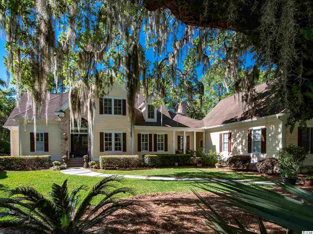 This lavish estate home was custom designed to accentuate the majestic beauty of it's surroundings in this exclusive section of Willbrook Plantation.  As you drive past the brick column entrance you are immediately struck by the centuries old Oak Trees that frame this property's almost 2 acres of manicured and natural setting.  The home, built by the current owners, was thoughtfully planned out for livability, comfort, Lowcountry style and high quality craftsmanship.  There are 4 bedrooms, 5 full and 1 half bath with the Master BR on the first floor.  Upon entering the residence you will be drawn to the wall of windows' that overlooks the back yard and navigable creek.  There are additional rooms that may also be used a guest bedrooms including a large Media Room, complete with Oversized screen, projection and surround sound, and a room over the garage currently being used as a game room with vaulted ceiling beautiful woodworking and a full bath.   There is a private boat ramp only available to the Oak Pointe property owners of this area, a lovely foot bridge leading to a fixed and floating dock and access to the Waccamaw River/ICW making this a select and unique property within the confines of Willbrook.  The community enjoys the safety of 24-hour gated security, the pleasure of a community pool, the convenience of an on site golf course and private beach access through the Litchfield by the Sea beach resort.  The community is a day trip away from Charleston, 30 minutes to the Myrtle Beach International airport, numerous attractions and Live Music venues or a short ride away from the Murrells Inlet Marshwalk restaurants and Watersports. Drive your golf cart to the beach.  This property has it all, location, convenience, majestic and serene living environment, great floor plan, high quality craftmanship, access to the River and the Beach in a private gated community.  Call today to tour this amazing home.