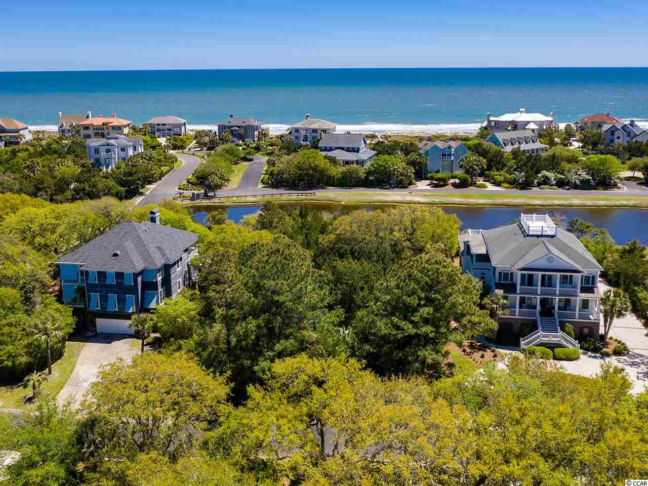 DeBordieu Colony - Sea Island -  Lot #29 is one of the unique, water front/ocean view opportunities in this charming section of DeBordieu. So near the beach, from Lot #29, you will walk approximately 250 yards on direct beach walkway to relax in waters of Atlantic Ocean - the perfect proximity for a home setting. Lot 29 is a short cart ride to the Beach Club, dining, pools, playgrounds, crabbing & fishing - making it ideal for the purchaser who takes pride in constructing a large, lovely, visible beach home. DeBordieu Colony offers access to 6 miles of secluded beach, 24-hour security gate, surrounding environment protections, private Fitness center, private golf & tennis, community boat ramp, saltwater creek access, boating, nature preserve with walking trails & bike paths, private indoor and outdoor dining options.