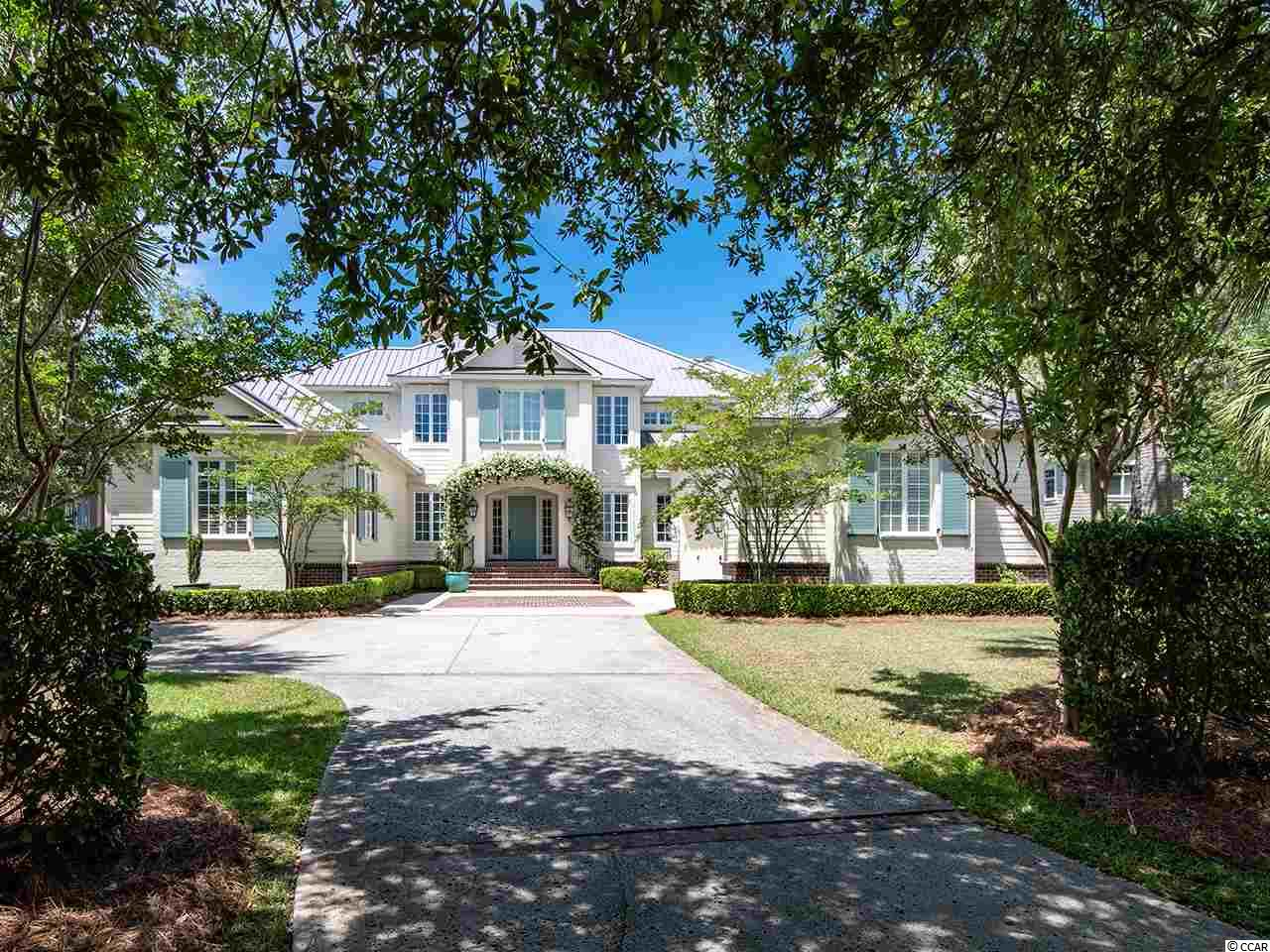 Outstanding North Inlet estuary views in the Ocean Green section of DeBordieu Colony.  6 bedrooms and 5.5 baths. Approximately 5000 heated sq. ft and 8200 sq. ft. Under roof. Features include: daily sunsets, media room, exercise room, 2 offices, 10' ceilings, Plantation shutters, 3 fireplaces, granite counters, 2 dishwashers, 2 clothes dryers, small pool, 2 huge screened porches. Oh yes - the views will take your breath away! DeBordieu Colony is an oceanfront residential community located just 5 miles south of Pawleys Island, South Carolina featuring private golf and tennis, saltwater creek access to the ocean, a 24/7 manned security gate, and unique luxury homes surrounded by thousands of acres of wildlife and nature preserves. People who have been here say there will never be a place as remarkable as DeBordieu. Come see for yourself!