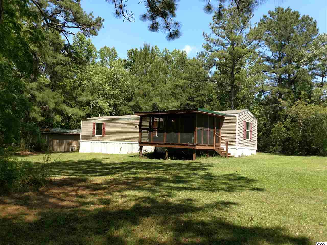1.6 acres located on the North Santee River. A walk way from the home to the river. Perfect for crabbing, shrimping and fishing. Has a 2016 14x60 manufactured home. Has a 12x16 screened in front porch. With a 14x38 shop/boat storage. Could be used as a weekend getaway or permanent residence. About 10 miles from Historic Downtown Georgetown. Shopping, waterfront restaurants and shopping. Georgetown was voted USA TODAY Best Coastal Small Town in America 2018. Square footage is approximate and not guaranteed. Buyer is responsible for verification.