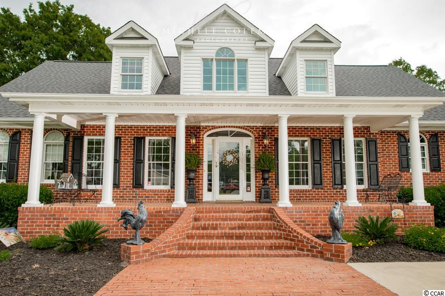 Price reduction!  Schedule your showing today. NO FLOODING EVER!!! And was totally assessable during floods. Truly one of a kind! The long driveway and 3 car carport will welcome you home! The main home has the Master Bedroom downstairs with a large Master Bath the features a separate shower and Garden Tub, also split sinks and a private toilet closet. The Walk-In closet is to die for with tons of built in's for any clothes needs you could have. There is an office that can also be used as a nursery that is attached to the Master. The large kitchen features a breakfast bar, eat-in area and plenty of storage. Off the kitchen is a Laundry room with more storage and folding and recycle area. Upstairs you will find 2 identical Bedrooms with their own separate Full Baths and walk-in closets. The walk-in closets lead into walk-in attic storage that runs the full length of the house. The Guest House features an adorable front porch and is over 600 Square feet and features a living room, full kitchen, Bathroom, Bedroom with a walk-in closet and laundry.