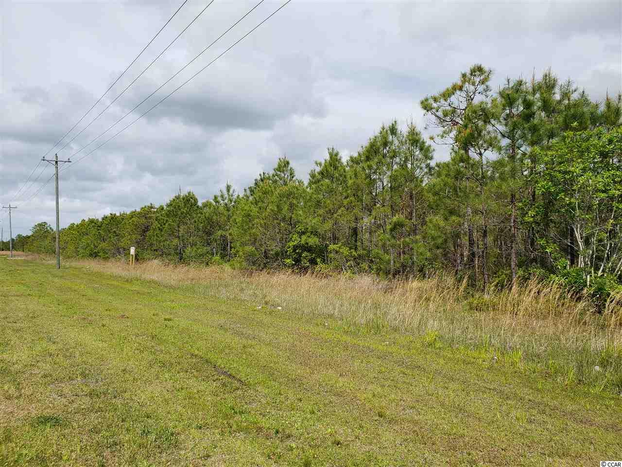 12.25 acres across the street from Barefoot Resort, located on Water Tower Rd. near the highway 22 and highway 31 intersection.  An amazing location for any commercial use or a subdivision.