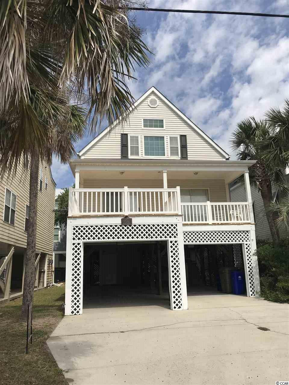 "This immaculate home sits just one row off of the Atlantic Ocean. Ideal open floor plan featuring 3 bedrooms and 3 full baths with high grade laminate wood floors. Front deck offers room for entertaining or just to relax with an ocean view. The ""Dream Maker"" house would be a great investment or vacation home for all beach lovers. Home is completely furnished turnkey, including washer and dryer. New roof installed in 2017. Deck has been redone in 2019. Close to the Garden City Pier and Surfside Beach Pier. Home is located close to entertainment, shopping and dining. Priced Thousands less than County Appraisal!"