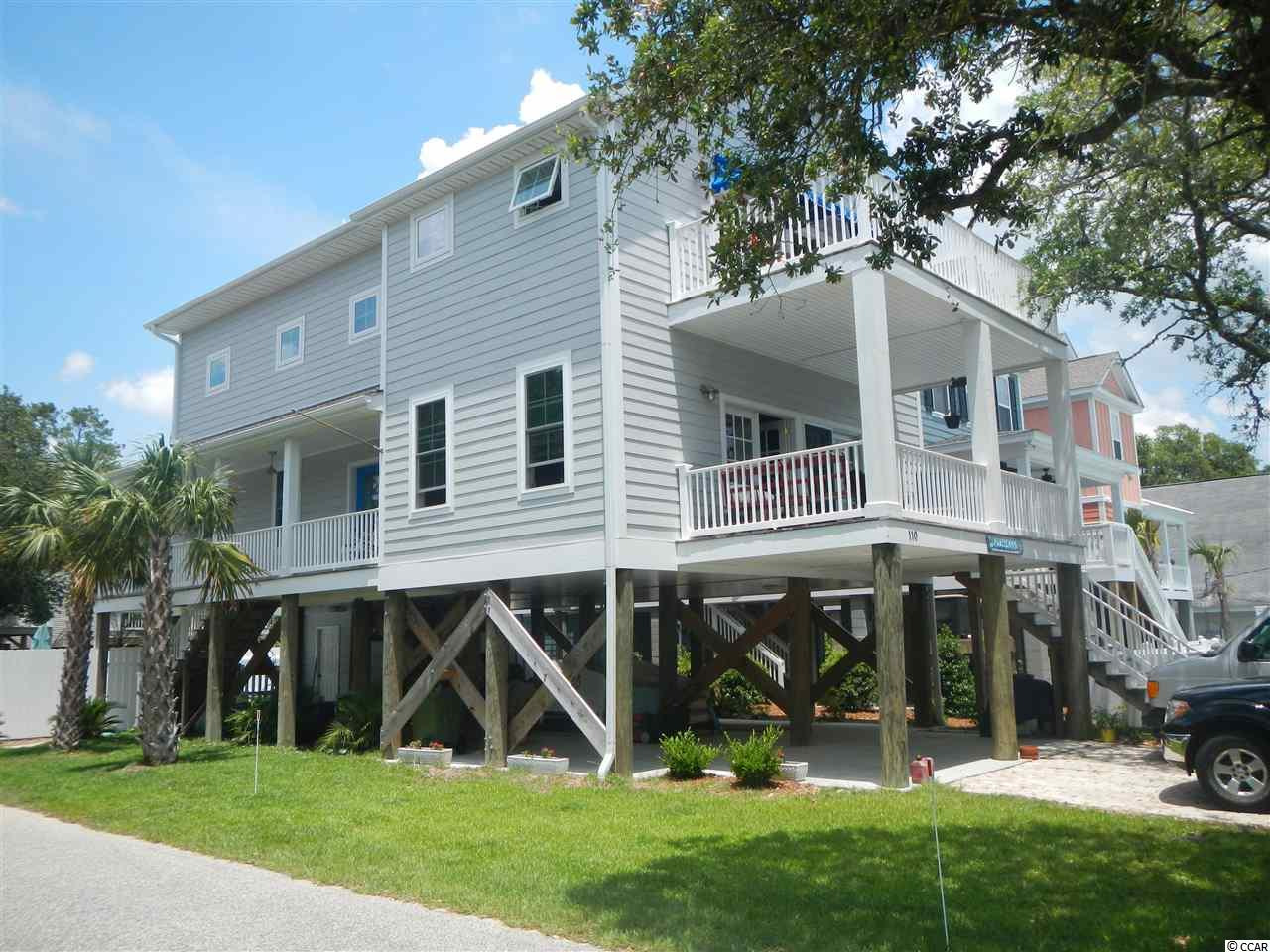 """Endless Summer"" is a Charleston style house located 600 ft from the ocean in a quiet section of Surfside, the ""family beach"". Home was custom built as a residence and has never been rented, but is zoned R3 for allowed weekly rentals. Quality construction and maintenance free features make this home the perfect family retreat. All 4 bedrooms have private baths, a separate TV room could be used as a 5th bedroom. A large living room is perfect for entertaining.  A corner lot and  an oversized pool enhance the desirable location of this home located near the pier, library, parks and tennis courts. Footages are approximate and buyer should verify"