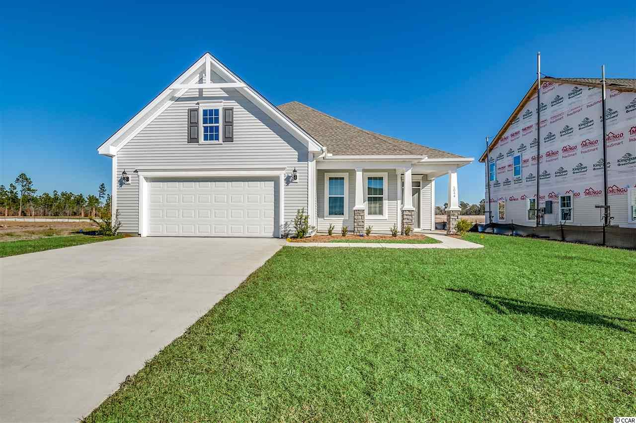 Ready to move in January!! Model Home open every day! Mon-Tues 11-5, Wed 1-5, Thurs-Sat 11-5 & Sunday 1-5. Ask about Flex incentive for closing by February 29th!!  Enjoy sunsets from the front porch and morning sun on your covered rear porch.  This 4-5 bedroom home with an open floor plan features, gas gourmet appliances, white shaker cabinets, quartz countertops, ceramic tile backsplash, under cabinets lights and a generous pantry in the open kitchen with a large eat-in area and additional seating at the counter height island.  The family room is defined by a tray ceiling.  All first floor main living areas on the first floor have Luxury Vinyl Plank flooring.  This floor plan is very versatile.  You can have five bedrooms and three full baths, or make one a bonus or office with the large bonus on the second level.  The master suite is located on the rear of the home.  The master is complete with tray ceiling, double bowl, raised vanity, tile shower, enclosed water closet and linen.  The master walk-in closet connects to the laundry room.  You can access the laundry also from the kitchen.  The other three bedrooms on the first level are on a separate hallway with a large shared bath with raised double bowl vanity.  The shower and water closet are closed off so that more than one person can use the bath at the same time.  From the garage entry you have a coat closet and linen which is conveniently located close to the guest bath.  Off the foyer are the stairs to the enormous bonus room which features a full bath.  And of course you can enjoy all of the our award winning hauSmat standard features like:   kitchen cabinetry with varied heights & large crown molding, comfort-height vanity with drawer stack in master bath, and the Bluetooth music port and speakers that you'll enjoy every day, Radiant Barrier Roof Sheathing, a Lenox HVAC System designed and tested by independent 3rd Party, R-38 Attic Insulation, and a Rinnai Tankless hot Water Heater that you'll  appreciat