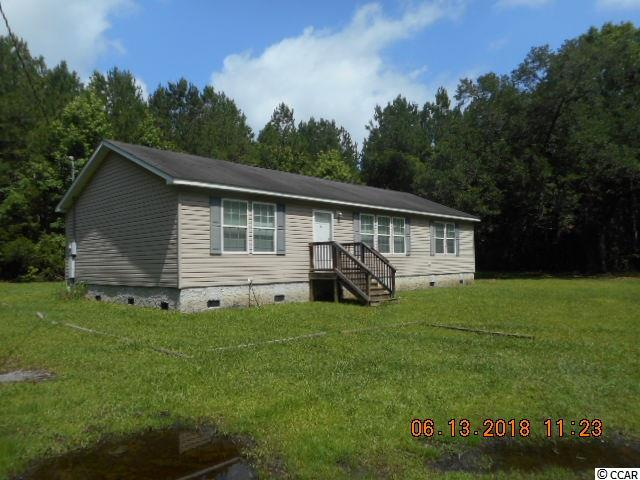 3 bedroom 2 bath modular home on private 1 acre setting. Follow the long private drive back to this spacious home. Home has split bedroom floor plan, living room, kitchen, and more. Located between Conway and Georgetown just off Highway 701.