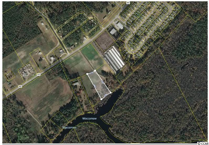 Looking for a piece of land directly on the Waccamaw River that did NOT FLOOD during Hurricane Matthew or Florence?  This is it!  2.45 of beautiful land to build on.  229' of water frontage along the river.   Convenient location right off of 905.  Adjacent 2.76 acre lot is also available for sale and listed separately.