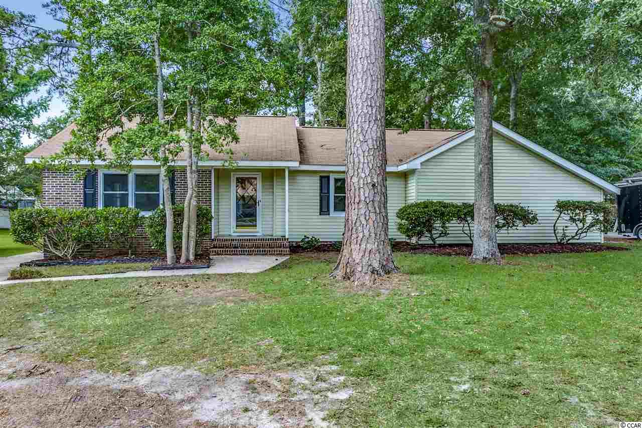 Surfside Living is calling you! This one level three bed, two bath home has been completely renovated and is just a few minutes from the beach on 5th Ave North! Enter into a welcoming open floor plan with a spacious living and dining area. The completely upgraded kitchen includes all new stainless steel appliances and freshly painted cabinets equipped with new hardware. A custom island has been installed with plenty of storage space and breakfast bar seating. Additional features include a brand new roof, new flooring and paint throughout, new fixtures, upgraded bathrooms, and both attached and detached outside storage. This home is located on a large lot in an area with NO HOA fees. Hop on your golf cart and be at the beach in minutes! Conveniently located just miles from Market Common, Murrells Inlet and shopping and dining at some of the most fabulous restaurants on the Grand Strand. Perfect full-time residence or second home. Your home at the beach is waiting!