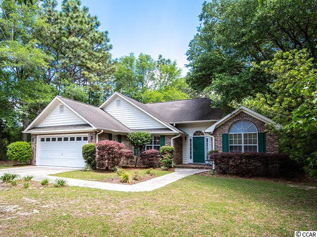 This patio home is one of the few brick homes left at this price point in a gated community in Pawleys Island.  It has a split floor plan and nice open feel with high ceilings in the combined den and dining area.  The master suite has a walk in closet and tile shower.  There is an average size fenced, shaded back yard with a patio for grilling, pets or children to play.   Enjoy a location that puts you in the middle of everything with shopping, dining, parks, rivers,  beaches and numerous cultural events to keep you occupied.   There are many neighborhood sponsored social events as well like card clubs, book clubs, wine clubs, sewing clubs, small plates/big pours and so on. Pay for only the amenities you plan to use.  The dues include basic internet, cable, digital phone, trash pick up, security gate and common area maintenance.  Pawleys Plantation is full of history as well as moss draped oak trees.   Add a few personal touches and make this home yours today.  It has a good rental history if you are not ready to move here permanently.   Measurements and HOA information should be verified.