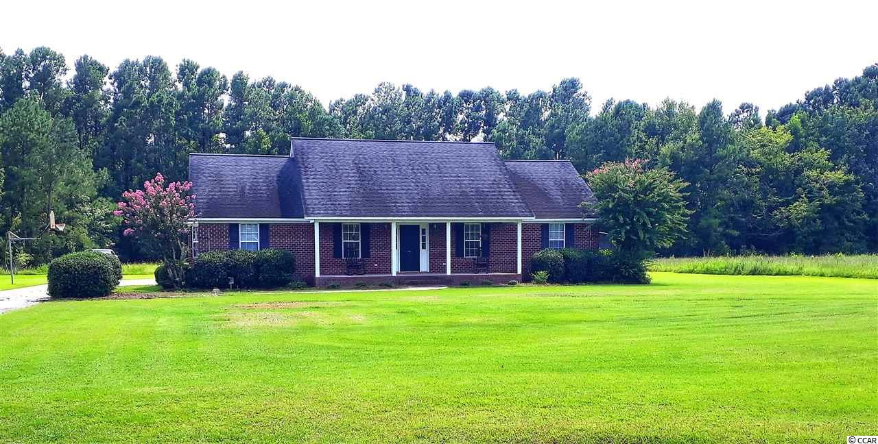 This stunning brick home sits just outside of the city limits of Conway SC. It has been very well maintained and has lots of living space as well as yard space. The home itself sits on a 1 acre lot, however you may purchase the adjacent 4 acre lot to go along with it. See MLS # 1911729. This price is for the house with only the 1 acre. There is an attached brick carport as well for 2 vehicles and a large storage room built on the back. The inside has too many upgrades to mention, but a few of them are: a large kitchen with custom cabinets, a work island, gorgeous hard wood and tile flooring throughout (except in the bedrooms which have carpeting), and the master bath boasts a very large 2 person whirlpool tub as well as a stand up shower. As quite and peaceful as this little community is, you will not even realize how close you are all of the attractions Conway and Myrtle Beach have to offer, but you are within minutes of it all. Just a few minutes from downtown Conway and Walmart. Come check out this lovely home right away. Do not miss out. Act Fast!!!