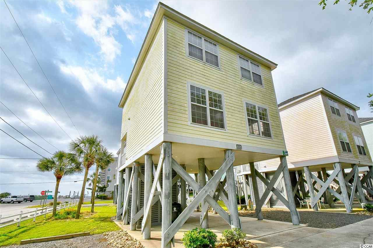 This beautiful raised 3 bedroom 2.5 bathrooms beach home has amazing views of the beach from the porch. This property has a community pool with HOA fees which include: Garbage, cable, landscaping/pool maintenance and building insurance.  Brand new heat and air unit.  Right in the heart of Murrells Inlet where you can find all the dining, entertainment, and all the shopping that Murrells Inlet has to offer!