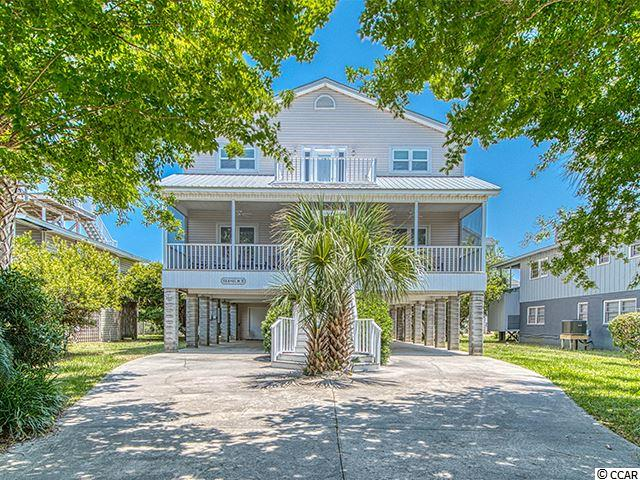147 Sundial in the beautiful coastal community of Litchfield Beach offers 6 bedrooms, 6 and one half baths with abundant living space for your guests.  It is a great family home to enjoy the beach. There are two living areas, one on each level. This is a roomy and inviting home. The open living space is great for entertaining. The home features a back and front porch as well as a balcony adjoining the large 2nd floor master bedroom and the ocean breeze and sound of the waves can be enjoyed from all of the outdoor spaces.  An elevator makes access simple and easy when unloading groceries and luggage. There is plenty of parking and storage under the home. It has a good rental history. The beach is as short stroll away and enjoy ocean front dining nearby.