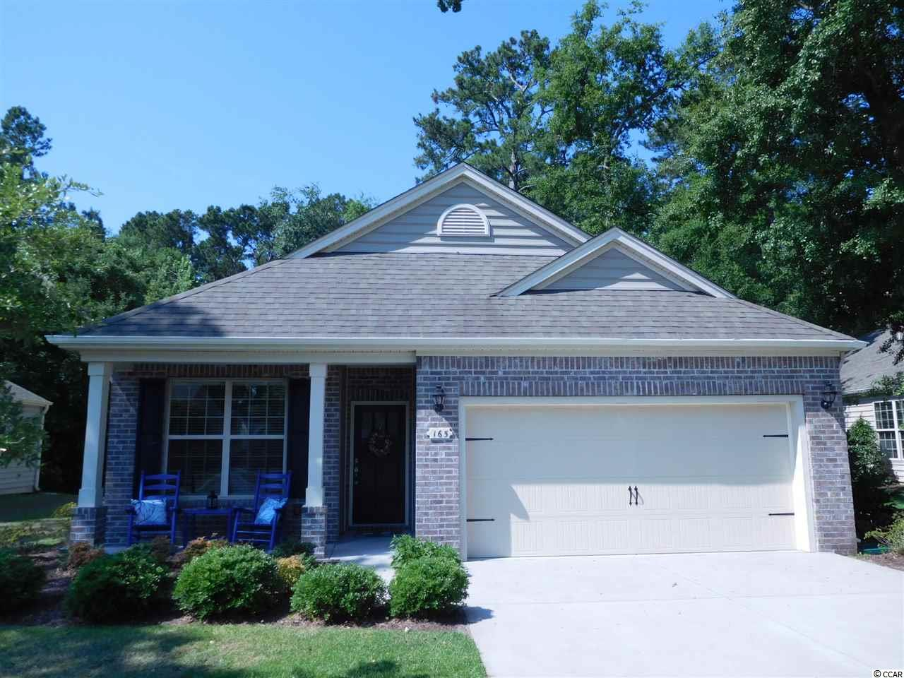 Meticulously maintained 2nd home with outstanding floorplan. Single level home with open floor plan in a wonderful neighborhood. Only one owner who had many options added to home during construction. Some of the extras are the wood floors, stainless steel appliances, deep single stainless steel kitchen sink, large master bedroom walk-in closet, master bath with separate shower and garden tub, beautiful gas fireplace, carpet in bedrooms, tile in bathrooms, ceiling fans in every bedroom. Whole house surge protector and propane hookup on patio for gas grill. Pantry, coat, and linen closets. 2-car garage. Flex room that can be used as a study, library, playroom, etc. This property backs up to a protected wooded buffer and is located adjacent to walking trails and fitness center. Beach is only 1/2 mile away! Square footage is approximate and not guaranteed.  Buyer is responsible for verification.